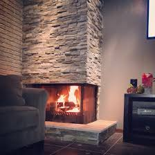 DIY fireplace- Home Depot Stacked Stone DIY fireplace base- wood frame with  sheet rock