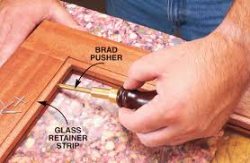 install the glass and retainer strips after you have stained finished all of cabinet parts predrill