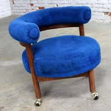 royal blue round corner chair with bolster back on casters mid century modern
