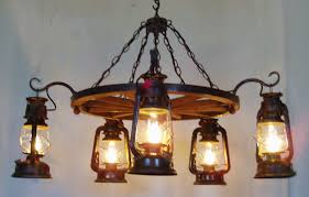 1 tier wooden wagon wheel chandelier with old fashioned lantern lights and decorative brackets