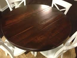 brown rustic round dining table finished feat white wooden armless dining chairs set as vintage interior dining space