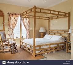 bamboo poster bed. Unique Bed Bamboo Fourposter Bed And Chair In Spanish Bedroom Floral Curtains At Tall  Windows  Throughout Poster Bed M