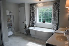 chic bathroom windows over tub chrome and glass bathroom etagere design ideas