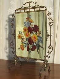 victorian brass and beveled mirror fire screen hand painted with a colorful bold fl