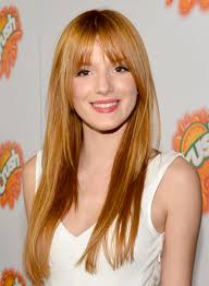 bella thorne s long chic straight red hairstyle with bangs