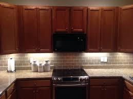 cabinet and lighting. Kitchen:Fascinating Kitchen Design With U Shaped Wooden Cabinet And Beige Subway Tile Backsplash Lighting N
