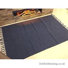 eco friendly plain navy blue handmade natural cotton fair trade reversible machine washable flat weave dhurrie rugs