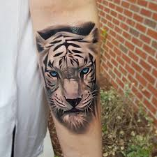 white tiger with blue eyes tattoo.  Eyes These Electric Blue Eyes White Tiger Tattoo  Inside Tiger With Blue Eyes Tattoo S