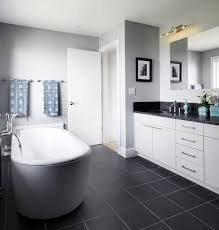 black and white bathroom furniture. bathroom with dark grey floor light walls white vanity black and furniture