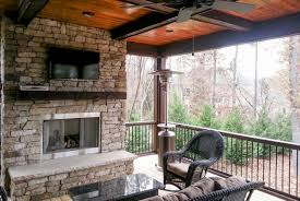 stainless steel fireplace in screen porch