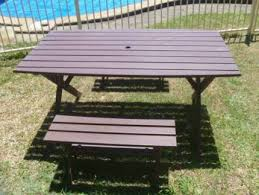 timber outdoor table with 3 seats excellent condition