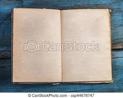 open blank pages of old book on wood background csp44678747