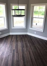 distressed luxury vinyl plank flooring in walkout bat lvp modern rustic new home