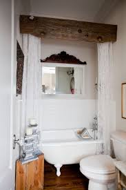 I love the wood beam for a shower curtain rod. Combine the Downton Abbey  lace panels with a rustic piece of wood for this charming look from Hill  Farmhouse.
