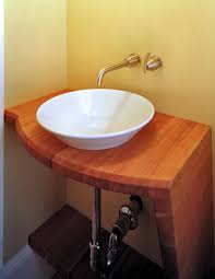 edge grain cherry vanity with vessel sink and waterlox finish