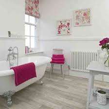 bathroom accent furniture. Bathroom : Pink Accent French With Oval White Clawfoot Bathtub And Cotton Towels On Grey Vintage Wood Single Chair Also Furniture