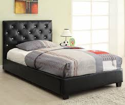 black upholstered twin bed