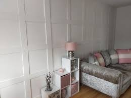 dining room with panel wall