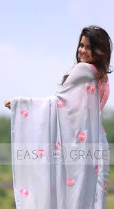 presenting a light steel blue pure georgette saree briar rose presenting a light steel blue pure georgette saree briar rose flowers hand crafted