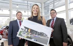 pictured unveiling plans for the new shelbourne motors plex in newry are the pany s s directors richard ward left and paul ward
