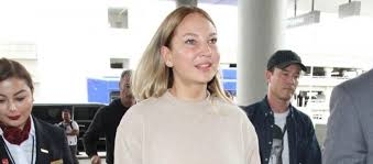 chandelier singer sia goes wigless at los angeles airport