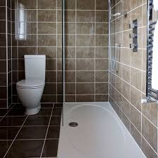 small shower room with neutral wall and floor tiles