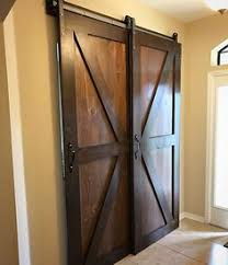 really hard to get a good photo here but these are our favorite most plicated doors to date two toned british brace barn doors on a single track byp