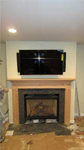 beforenafter a new gas fireplace with custom stone wall into for mounting tv above brick fireplace