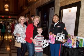 marine corps band new orleans the saenger theatre and chevron collect donations for toys for tots at santa meets sousa concert the ehrhardt group