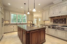 if i were sold on white cabinets i would do this.light cabinets with dark  island, and dark granite counter tops