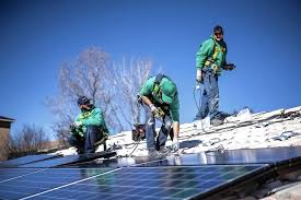 workers install solar panels for solarcity on the roof of a home more companies are