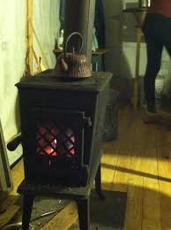 chic dark jotul wood stove fireplace on wooden floor for warming room decor ideas