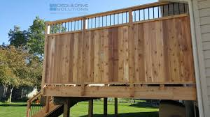 new cedar deck with custom privacy des moines deck how to build a patio privacy wall
