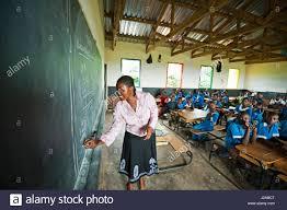 malawi lilongwe chambwe primary school ndawona kawaza teaching her class arithmetic unicef s kids in need of desks project has provided 420 desks