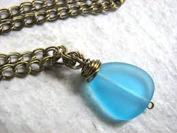 wire wrapped recycled glass pendant. Recycled Sea Glass Necklace In Blue And Brass Wire Wrapped Pendant