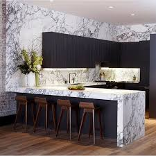 art deco inspired modern gold and marble finishes amplify the art deco inspired aspect of this otherwise classic kitchen and the built in bookshelf and art deco inspired kitchen