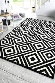black and white geometric rug art black cream colours harrietta black white geometric rug