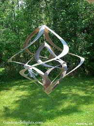 garden art. Kinetic Wind Sculpture Incorporates A Beautiful Use Of Sculptured Metal Pieces Which Spin In Opposite Directions Garden Art