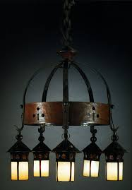 gustav stickley model no 223 chandelier wrought iron and hammered copper mounts with copper and glass lanterns