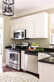 Height Of Top Cabinets The Yellow Cape Cod Making Cabinets Taller Builder Cabinets Go