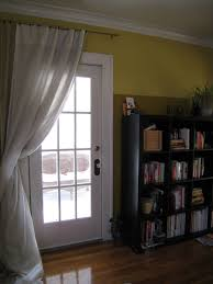 To curtain off patio door to save cooling costs...w/ thermal curtain ...