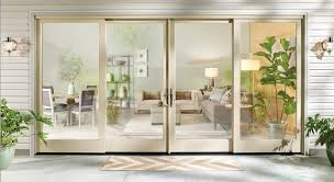 milgard essence series patio doors combine durability with a stunning wood finish