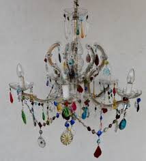 a crown shape marie therese decorated with multi coloured drops and swags