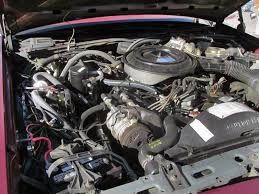 this clean looking engine is ford s 302 v8 with 140 hp and 250 ft lb of torque for a 3 900 pound car that s not a lot of get up and go but this car is