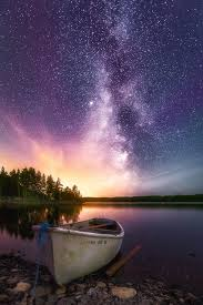 Light in Darkness A touch of magenta aurora a milky way and a