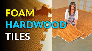 these foam tiles give you instant hardwood flooring