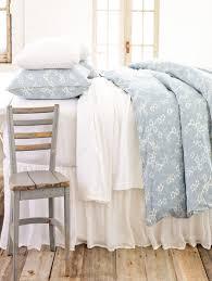 simple white matelasse bedspread with aqua fl bed blanket