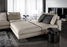 living room with bed: white sofa bed design and stone glass round coffee table at living room ideas