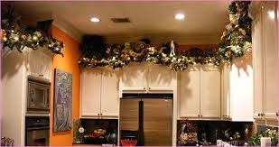 what to put above kitchen cabinets white counter storage design ideas chimney recessed lights black iron