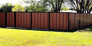 wood and metal fence with h framed corrugated plans